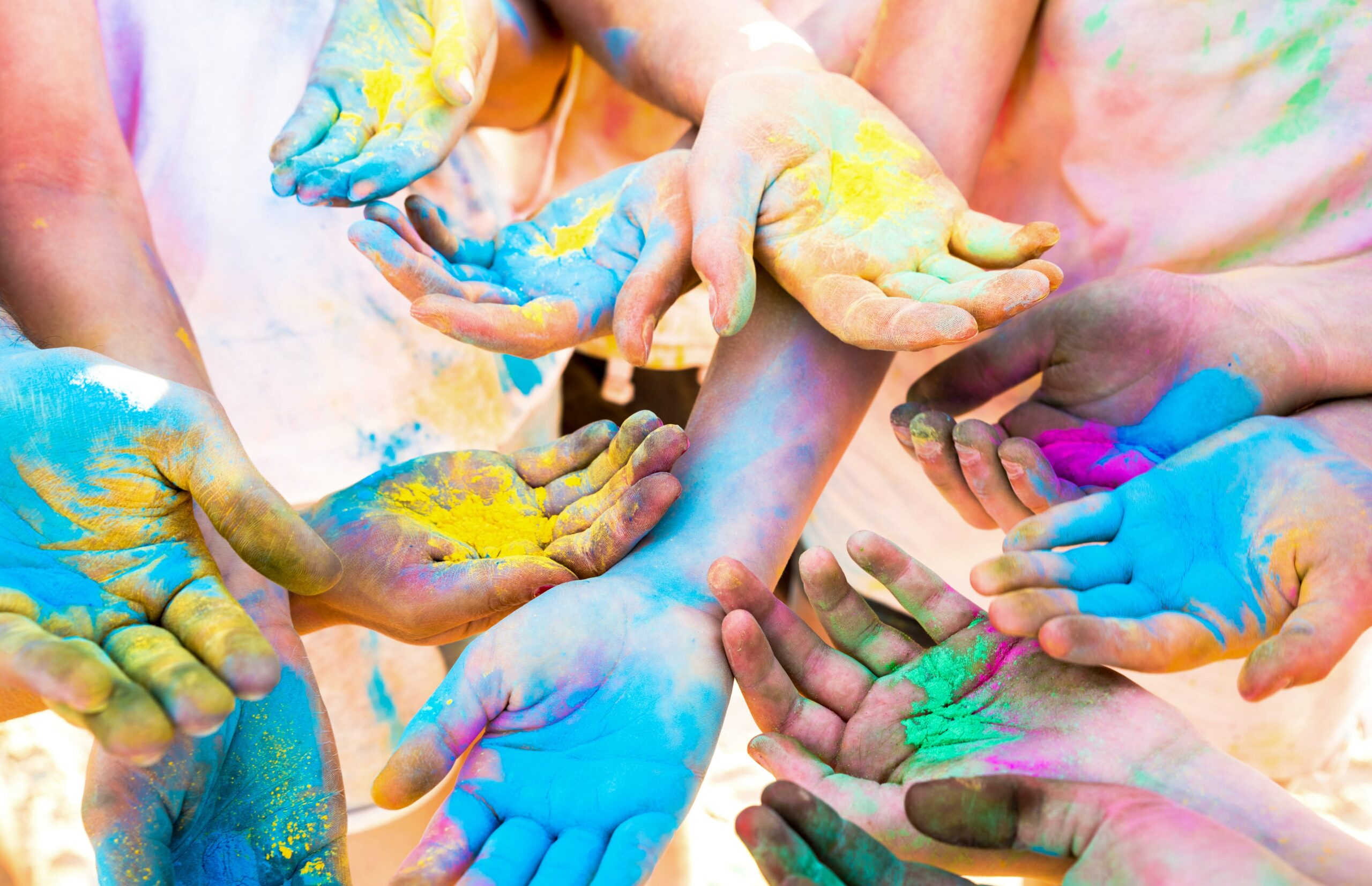 colorful hands of friends group having fun at beac 2u465wf min